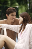 Young couple enjoying each other by the pool - Asia Images Group