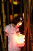 Little girl holding Chinese lantern - Asia Images Group