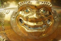 Bronze lion head on incense bowl - Asia Images Group