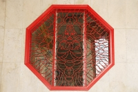 Octagonal window with lattice work showing Buddha - Asia Images Group