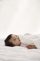 Baby girl with blanket - Asia Images Group