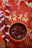 Still life of bowl of Chinese new year goodies - Asia Images Group