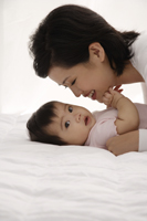 Woman with baby girl - Asia Images Group