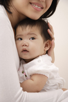 Woman holding baby girl - Asia Images Group