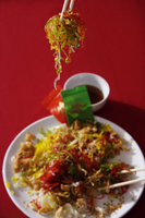 "Tossing raw fish salad also known as ""Yu Sheng"" or ""Lo Hei"" - Asia Images Group"