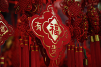 "Still life of hanging decorations with Chinese character for ""fortune"" - Asia Images Group"