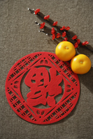 "Still life of pair of mandarin oranges with Chinese character for ""fortune"" - Asia Images Group"