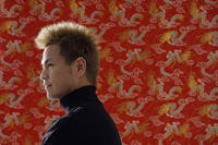 Profile of smiling man, Chinese silk backdrop - Asia Images Group