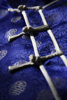 Detail of silk buttons on Chinese shirt - Asia Images Group