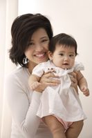 Young woman with baby girl - Asia Images Group