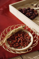 Still life of wolf berries, ginseng and red dates - Asia Images Group