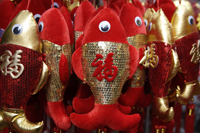 "Still life of hanging decorations of fish with Chinese character for ""fortune"" - Asia Images Group"