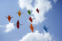 multiple paper cranes against sky backdrop - Asia Images Group