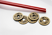 Chinese coins with red chopsticks - Asia Images Group