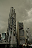 Cityscape against dark gloomy skies - Asia Images Group