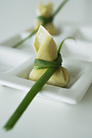 wanton dumplings placed on a white dish - Asia Images Group