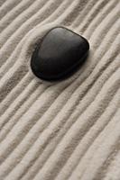 closeup of zen garden pebble detail on raked sand - Asia Images Group