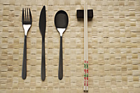 fork, knife, spoon and chopstick dinner setting - Asia Images Group