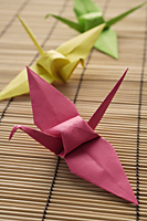 pink, yellow and green paper cranes - Asia Images Group