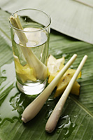 lemon grass stalk in glass of water with star fruits - Asia Images Group