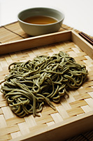 cooked soba noodles with sauce on the side - Asia Images Group