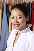 portrait of Chinese fashion designer smiling at camera - Asia Images Group