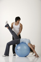 Man and woman working out - Asia Images Group