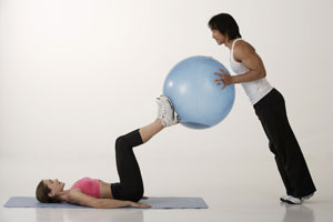Couple working out with exercise ball - Asia Images Group