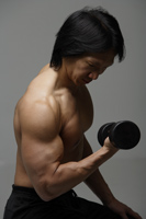 Man working out with free weight - Asia Images Group