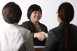 business woman shaking hands - Asia Images Group