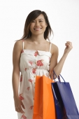 Woman carrying shopping bags. - Asia Images Group