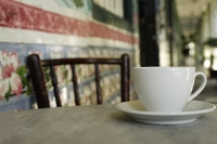 Close up of coffee cup on marble table in China Town, Singapore. - Asia Images Group