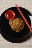 Noodles on plate with chopsticks. - Asia Images Group