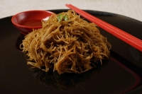Bee hoon noodles on plate. - Asia Images Group