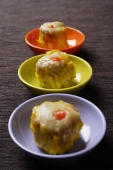 dim sum on colored plates - Asia Images Group