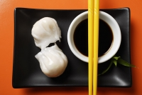 dim sum on plate with soy sauce - Asia Images Group