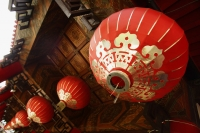 red lanterns hanging from temple roof - Asia Images Group