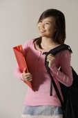Young woman with backpack and folder. - Asia Images Group