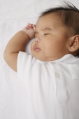 Head shot of sleeping baby. - Asia Images Group