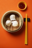 still life of dim sum in bamboo steamer with chopsticks - Asia Images Group