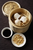 still life of dim sum with bamboo steamer - Asia Images Group