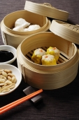 still life of dim sum in bamboo steamers - Asia Images Group