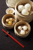 Assortment of dim sum in bamboo steamers. - Asia Images Group
