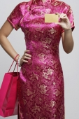 cropped shot of woman holding a credit card and shopping bag. - Asia Images Group