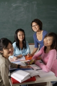 Four young women studying together. - Asia Images Group