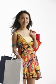 Woman holding shopping bags. - Asia Images Group
