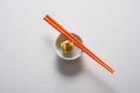 dim sum in bowl with orange chopsticks - Asia Images Group