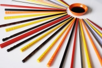 colorful chopsticks displayed on a table - Asia Images Group