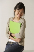 young woman holding a folder. - Asia Images Group