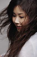 Head shot of Chinese woman with long hair - Asia Images Group